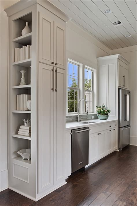 above refrigerator cabinet built in cookbook shelves design ideas