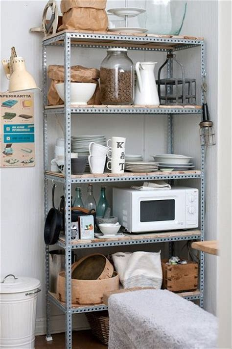 metal shelf unit  wood shelves   appliances