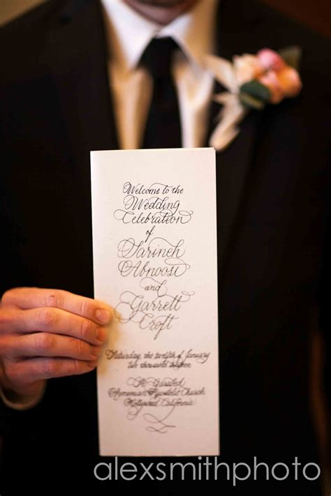 wedding bulletin groom holding wedding bulletin wedding notes wedding wedding bulletins