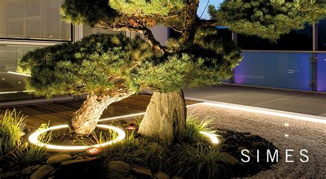 Striking Outdoor Lighting by Striking Curve Lighting Frames Simes Miniround Form And