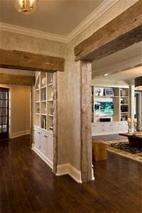 love the rustic barn framing with the formal baseboard With barn wood trim ideas