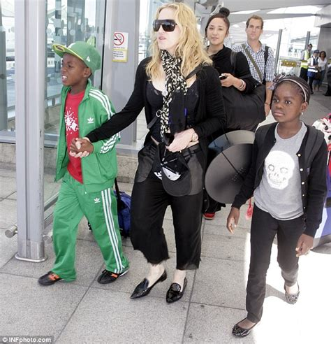 madonna touches down in london with youngest children mercy and david in tow daily mail online