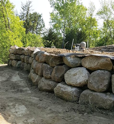 boulders for retaining wall swimming pool boulder walls