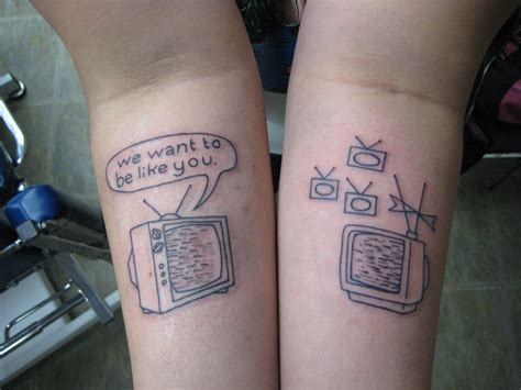 grey television tattoos   forearms