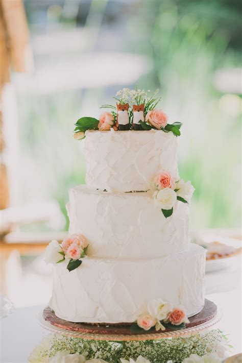 rustic white wedding cake topped with foxes