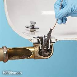 how to fix a clogged toilet and bathtub