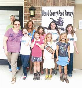 Girl Scouts visit Heard County Food Pantry