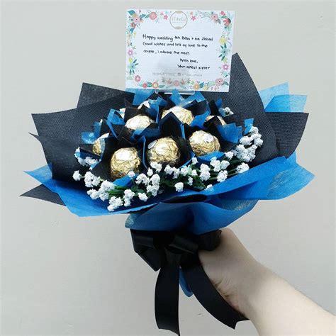 buket bunga coklat ferrero wisuda wedding anniversary blue curacao buket coklat wisuda murah surabaya