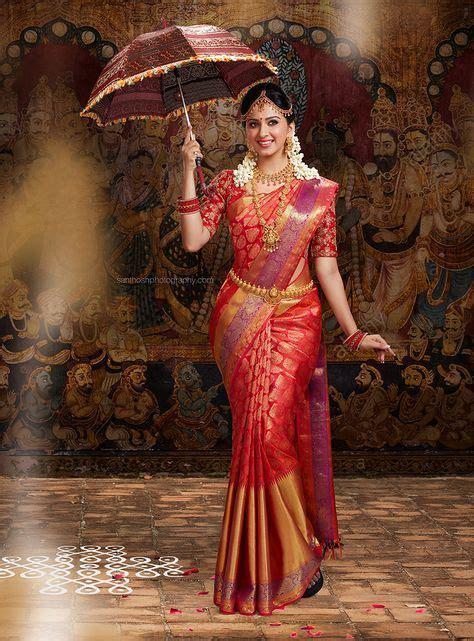south indian bride wearing silk saree  holding