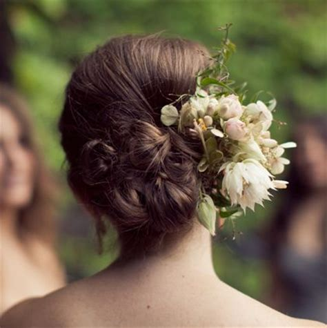 cluster  buns  flowers wedding careforhaircouk