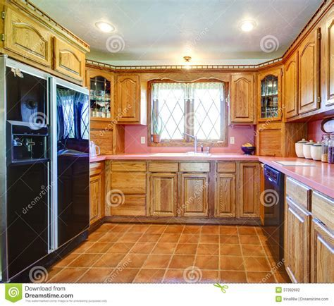 Farmhouse Kitchen Room With Wood Cabinets And Pink