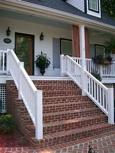 Red Brick Steps Provide Contrast To The Bright White Home