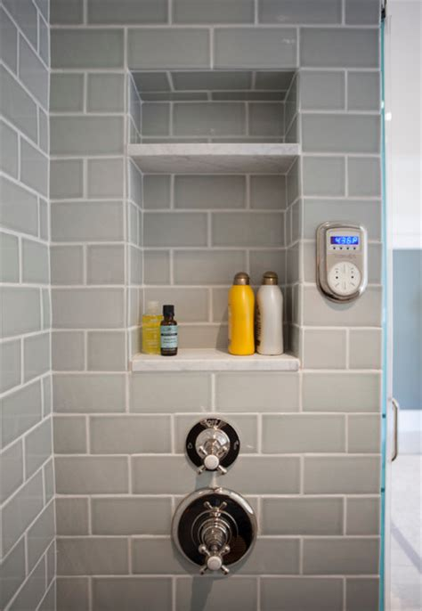 white marble shower cubby  blue tile transitional