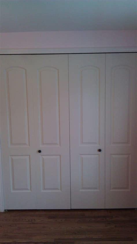 bifold door knob placement