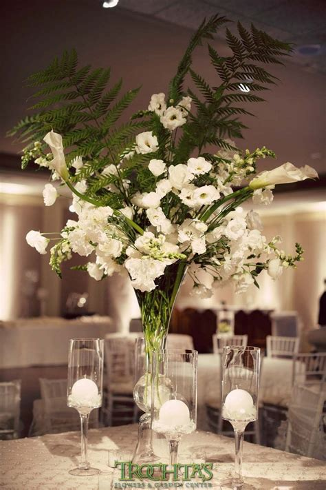 Tall White Floral Centerpieces With Large Fern Leaves For