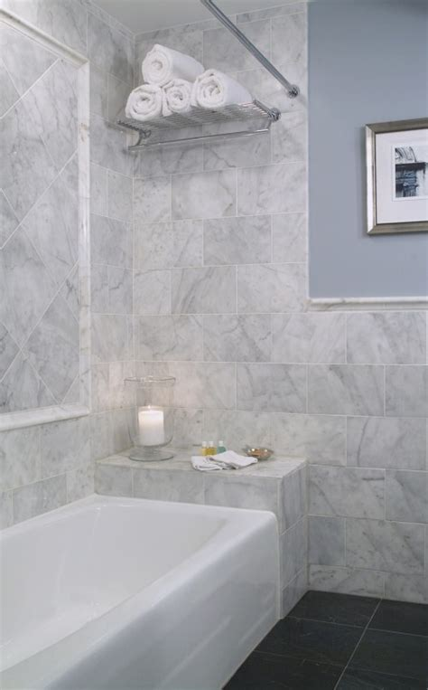 bullnose subway tile to the edge of the shower chair rail