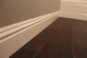 baseboard with tile look like wood floor floors ceramics faux wood flooring and