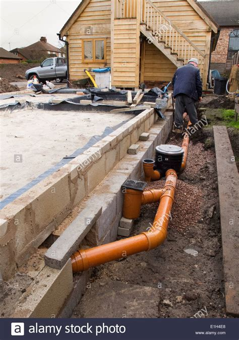 self building house, drainage, man making drain pipe
