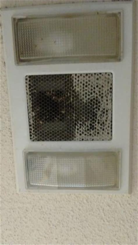 change lightbulb  bathroom lightheaterfan