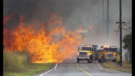 honolulu firefighters battle large brush fire  kunia