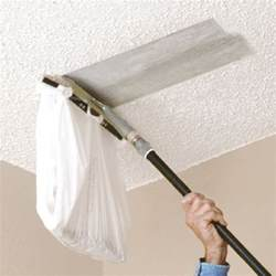you can attach a plastic bag to this popcorn ceiling scraper from homax to make scraping your