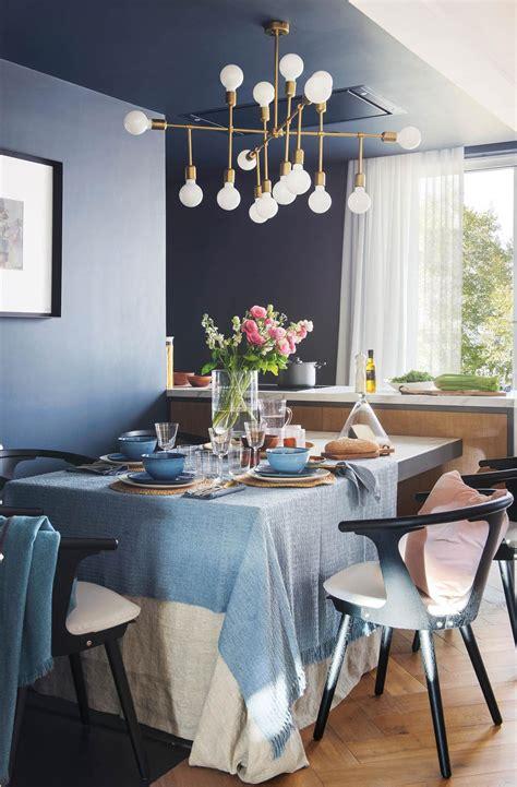una lampara escultural decoracion comedor azul