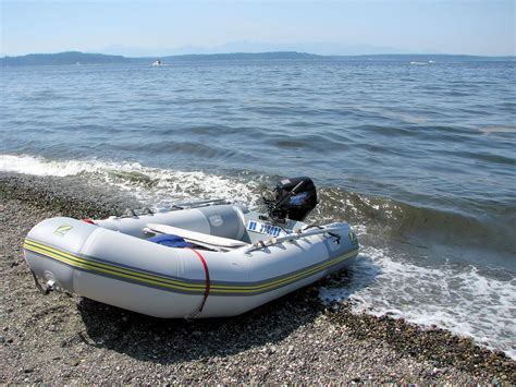 Small Zodiac Boat With Motor by Boat