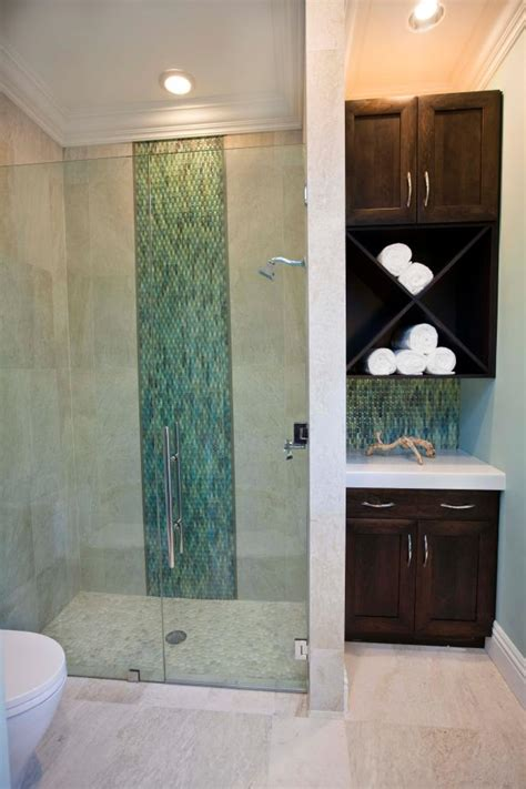 transitional poolhouse shower  pebble floor hgtv