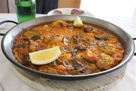 recette cuisine traditionnelle paella la vraie recette de la paella comme à valence