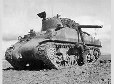 Crewman Adjusts Boggie Wheel on M4 Sherman Tank in Tunisia