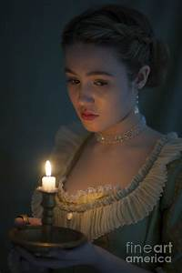 Young Beautiful Historic Woman Holding A Candle Photograph