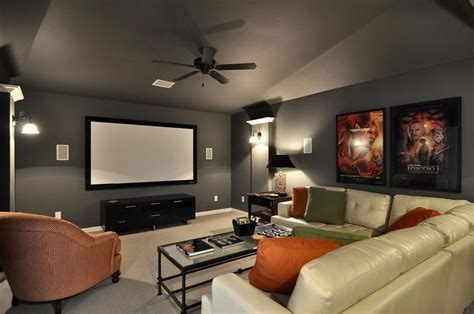 i like the gray walls in this media room with the pop of orange for color media room ideas