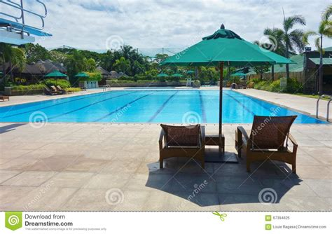 swimming pool umbrella and chair stock photo image 67394625