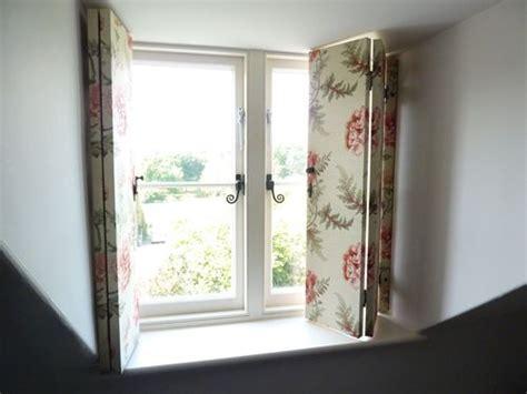 fabric covered shutters  dormer window