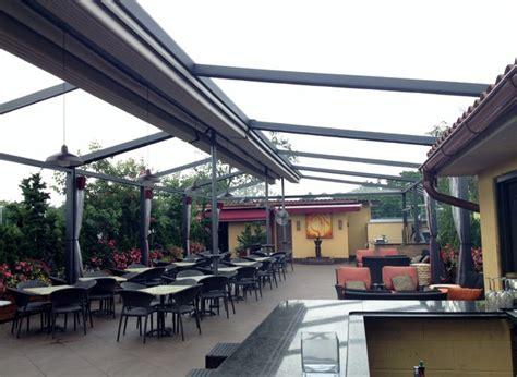 gennius retractable pergola awning  restaurant penthouse dining area mediterranean patio
