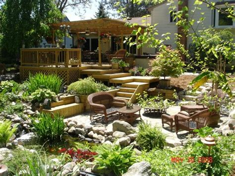 Backyard Paradise Landscaping by Amazing Outdoor Patio Deck With Water Features And