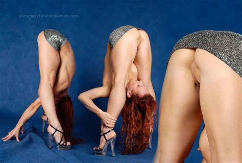 Flexible Bent Over Girl Looks At Her Own Naked Pussy