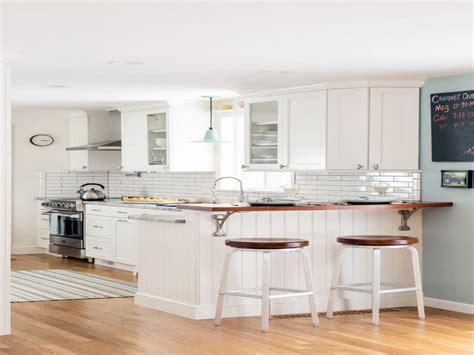 white kitchen subway tile backsplash shiplap island wood