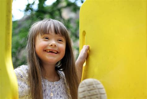 what is s facts yourgenome org 100 | Young girl with Down's syndrome on playground