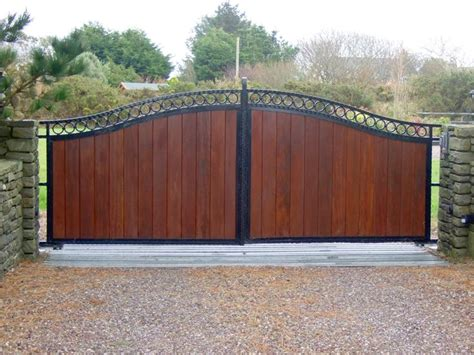 wood and metal gates wooden gates with black metal frame iron gates bandon iron gates iron gates aren t just for