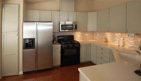 New cabinets, under cabinet lighting, tile backsplash