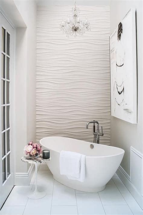 white wavy tile bathroom features an accent wall clad in wavy