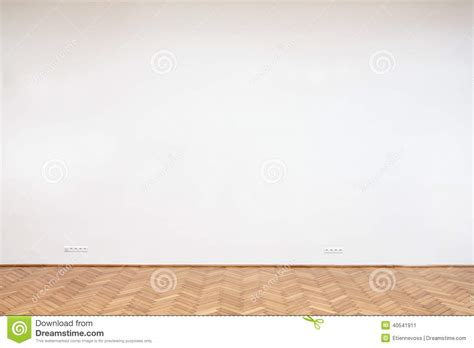 large white wall with wooden floor stock photo image