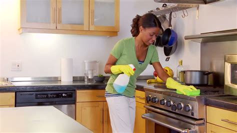 cleaning the kitchen cleaning kitchen counter and stove stock