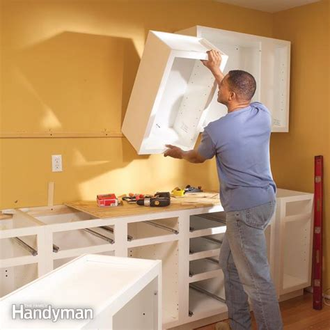 easy way to hang cabinets installing kitchen cabinets the family handyman