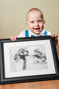 grown up preemie children pose with pictures of themselves