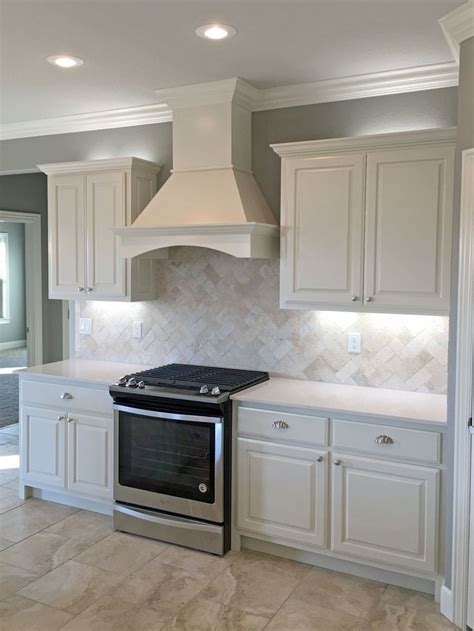 Kitchen Countertops With Backsplash by White Kitchen With Satin Nickel Fixtures Pendant Lights