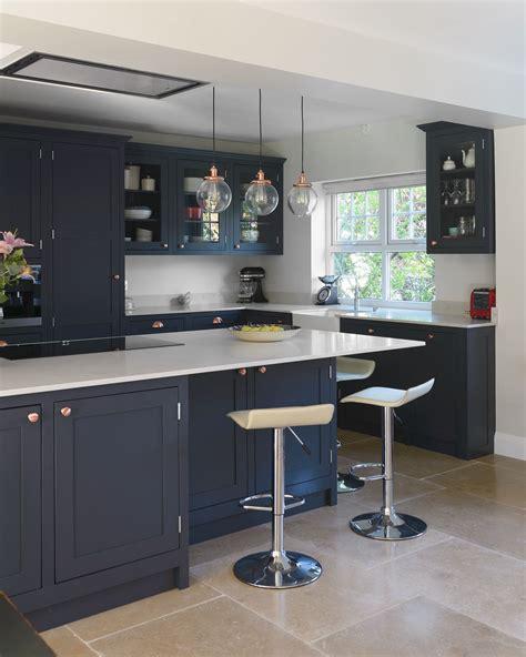 dark shaker kitchen  breakfast bar  pendants