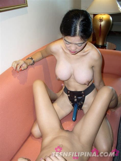 busty asian bar girl pounds her skinny friend with a strap