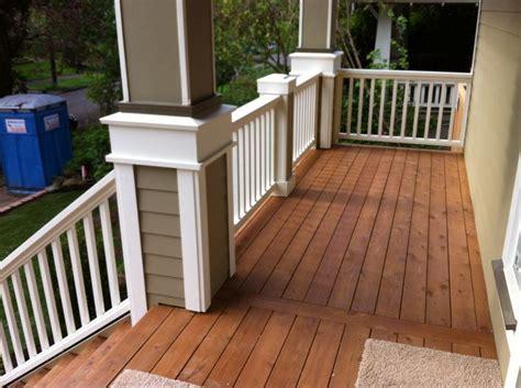 stained cedar decking  wood railing idea